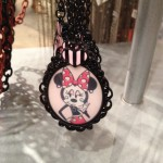 This highly stylized Minnie is showing up on more pieces!
