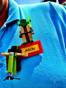 Jason, a designer and master builder for the Star Wars Miniland Cluster project, proudly showed off his name tag figures.