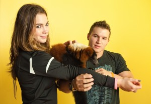 McKayla and Jonathan with Zeny the red-ruffed lemur