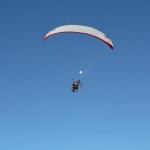 Paraglider dropping a parachute