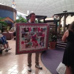 A fan made this quilt of pictures of David
