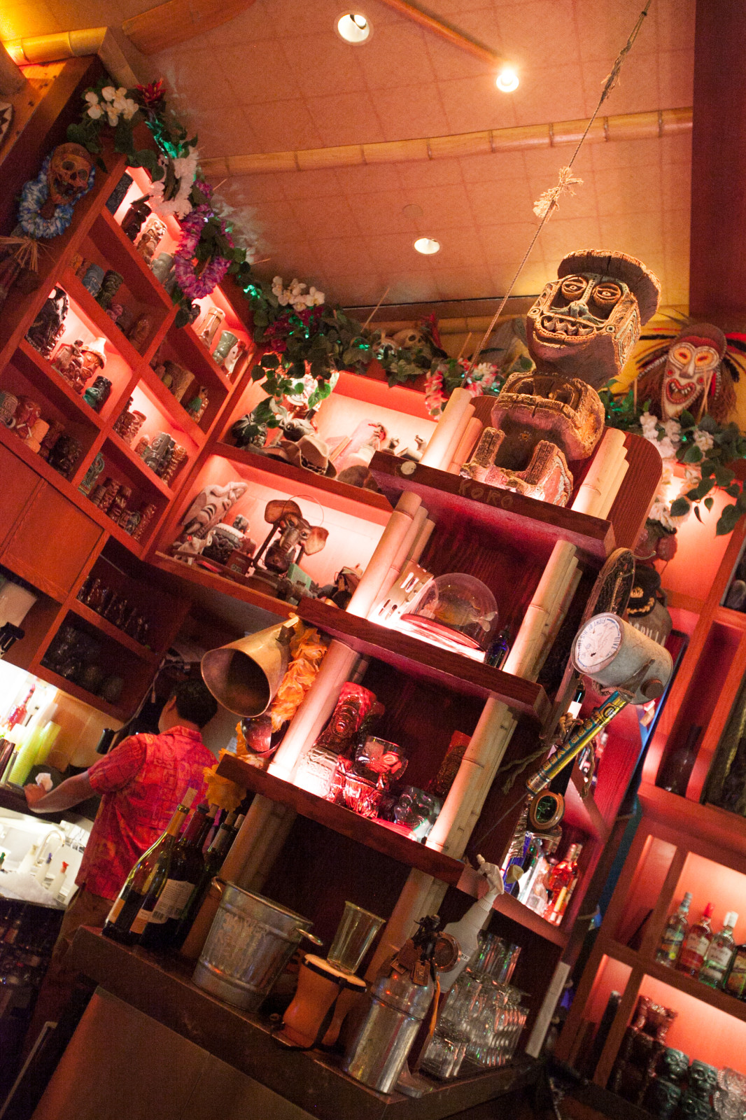 Tiki mugs, a pirhana, and some familiar tiki gods inside Trader Sam's.