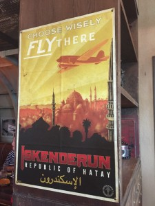 "Iskenderun poster with the headline ""Choose Wisely Fly There"" referring to the knight's advice to Indy to choose wisely when picking the Holy Grail in Last Crusade"